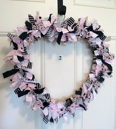 like this, uses fabric.link to post:http://adiamondinthestuff.blogspot.com/2011/01/valentine-rag-wreath.html