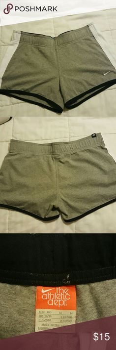 Nike workout shorts Medium Nike gray workout shorts with dark blue and white trim. Too small for me. Worn a few times, in great condition. Nike Shorts