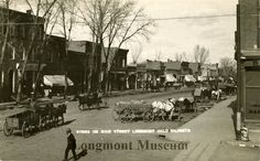 Scene on Main St. Longmont, Colorado Date Range from 1910 to 1915