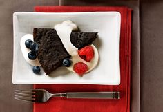 Dense wedges of chewy chocolate are paired with a sweet coffee-flavored cream and fresh berries. See the recipe video below. National Brownie Day, Blueberry Chocolate, Sweet Coffee, Substitute For Egg, Valentine Treats, Whipped Topping, Serving Plates, Holiday Baking, Food Videos