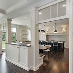 not this grand, but idea of columns and transoms to divide kitchen and living room