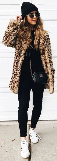 black sweater, skinny pants, panther coat, sneakers,
