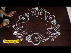 Lotus flower kolam designs with 9 dots Rangoli Designs Peacock, Rangoli Designs Latest, Simple Rangoli Designs Images, Rangoli Border Designs, Rangoli Designs Diwali, Rangoli Designs With Dots, Rangoli With Dots, Beautiful Rangoli Designs, Quilling Designs