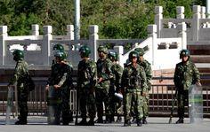 Police in China's Xinjiang region shot dead 13 assailants