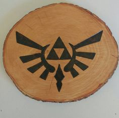 Check out this item in my Etsy shop https://www.etsy.com/ca/listing/476990917/zelda-tri-force-wood-burning