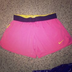 Nike livestrong pink and yellow shorts. Medium. Nike livestrong pink and yellow shorts. Medium. Has a very small spot shown in picture 3! Price reflects! Nike Shorts