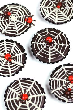 These Mini Chocolate Ganache Spiderweb Tarts are just the right mixture of spooky, innocent and elegant. They are the perfect dessert for a black-and-white Halloween party or dinner. from @feastandwest