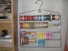 the best (and simplest) ribbon storage idea I've come across. It's a pants hanger!