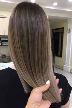 Mushroom Brown Hair Is Trending for 2018—And It's Much Prettier Than It Sounds | Cool and earthy, this shade is surprisingly refreshing for spring and summer. When sunny and warm summer days are finally on the horizon, most Southern ladies are ready to freshen up their look with a new cut or color in anticipation. While your first instinct might be to match the weather with warm tones like gold, honey, caramel, and chestnut, we argue that the best approach to the changing season is the new