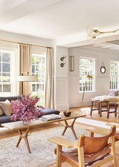 an expansive living room features warm neutrals and tons of light | pilar guzman house tour via coco kelley