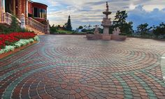 Pavestone Company  Combining the soft curved edges of the rectangular and square pavers, brings a gentle and warm effect.