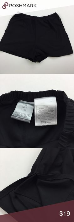 """Nike Shorts Black Nike shorts. These shorts have a liner and an outer layer with vents about halfway up the sides. Elastic waist. There is a plastic tag at the left hip that looks like it was a bit warped or melted by heat. Otherwise, no notable defects. Inseam is about 1.5"""" on the outer layer. I have lots of Nike shorts listed, so please check out my other listings! (431) Nike Shorts"""