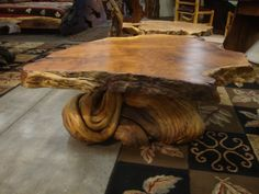 I love this table! It's made from twisted juniper and redwood burl. Rustic log originals by Kelly Maxwell.