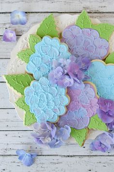 Hydrangea Cookies - by Glorious Treats....  This woman is amazing!  Love her cookies and cupcakes:)  She also gives GREAT tutorials on how to do the decorating, would love to try these!!!  Thanks Aunt Joy for the tip;)