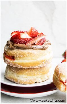 Learn how to make perfect homemade jelly doughnuts with detailed instructions. Make them more delicious by topping them with fudge frosting and strawberries