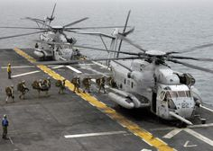 Sikorsky CH-53E Super Stallion is the largest and heaviest helicopter in the United States military. BLT 2/2, USMC: U.S. Marines attached to Battalion Landing Team 2/2 board a CH-53E Super Stallion helicopter aboard amphibious assault ship USS Bataan (LHD 5) April 2, 2007, in the Persian Gulf.