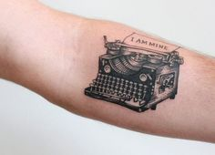 "Outstandingly good looking forearm tattoo of a vintage typewriter and printed words -- ""I am mine"". Every detail is tattooed perfectly."