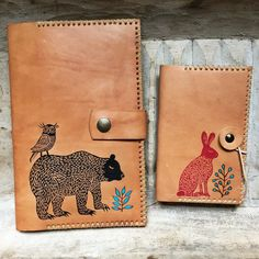 Moleskine covers! Hand stitched leather journal cover designed and made by Manolo. Burned decoration and stamp made by Geninne. Natural cowhide finished with wax salve.You can choose between two designs: Hare and Bear