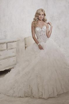Balletts Bridal - 22333 - Wedding Gown by Jacquelin Bridals Canada - Walk the aisle in this remarkable bridal ball gown, featuring cascading ruffled tulle and organza and studded with symmetrical stone patterns on the strapless bodice