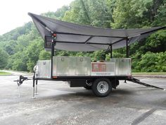 One phase to building the cargo trailer with kitchen and fold out rooftop tent: Build the roof supports with folding arms to support a canopy. DIY Utility Trailer Camper |