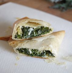 Spanakopitas filled with garden fresh kale toasted pine nuts feta and a hint of nutmeg. Pita Recipes, Easy Appetizer Recipes, Gourmet Recipes, Snack Recipes, Healthy Recipes, Yummy Recipes, Savoury Recipes, Savory Snacks, Healthy Foods