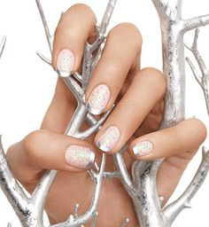 Try a metallic take on the classic French manicure! Start by applying a white base coat, and when that dries, swipe on a layer of your favorite glitter polish. Finish it off with a steady swipe of metallic on the tip. To ensure a smooth curve, create that French tip in two steps: start with a horizontal arc from the left side to the center, followed by the same on the right side.