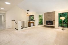 Living Room w/Vaulted Ceiling & Fireplace