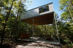 Japanese studio Go Hasegawa has designed 'pilotis in a forest', a weekend house