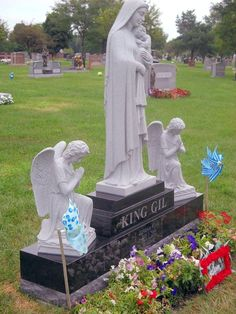 Photo of West Memorials - Memphis, TN, United States. West Memorials monument design Mother Mary with two kneeling angels. Custom Carrara marble and black granite headstone.