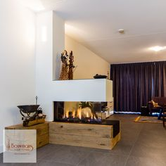 Modern fireplace option for the basement, I like the warmth that the wooden base brings. Put some plants on top. Home Fireplace, Modern Fireplace, Living Room With Fireplace, Fireplace Design, Fireplace Ideas, Home Living Room, Interior Design Living Room, Living Room Decor, Minimal House Design