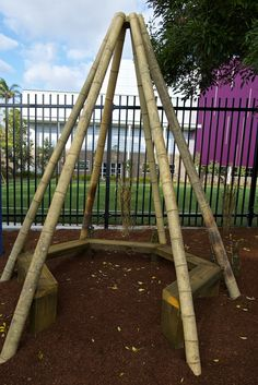 A large bamboo teepee seat is ringed with sensory plantings and fragrant climbers which will grow upward and between the poles creating a shaded intimated small group area/storytelling space