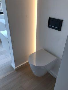 Designer wall hung toilet with led lighting along the wall Chic Bathrooms, Dream Bathrooms, Small Bathroom, Toilet Room, Wall Hung Toilet, Bad Inspiration, Bathroom Inspiration, Modern Wood House, Minimalist Bathroom Design