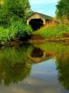 Covered bridge reflected in water!