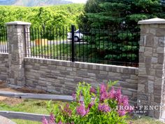3ft tall wrought iron fence installed on an engineered stone wall top and pillars