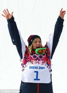 Bronze medalist Jenny Jones celebrates during the flower ceremony for the Women's Snowboard Slopestyle Finals