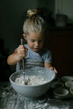 little girl cooking with her mom