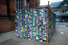 Tapehouse (2010) by Emmett McNamara (http://tryingtobeanarchitect.blogspot.com). 7,200 used cassette tapes were connected with plastic zip ties to form walls that were then hung from scaffolding. The structure was built on the campus of the Edinburgh College of Art in Scotland.  [ #cassettes #cube #installation #music ]