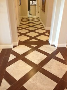Dark hardwood flooring with light colored porcelain tile inlays. Very elegant and classy look to add interest to this hallway. Tile and wood flooring available at Express Flooring in Phoenix, Arizona.