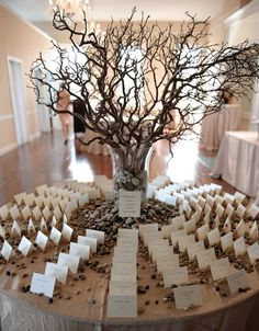 like the idea of branches with all the place cards around it