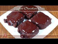 Eggless Chocolate Cake Recipe by Manjula -- i'm going to try this and sub coconut oil or buttery spread (instead of dairy butter), nut milk and for the ganache full fat coconut milk. Indian Dessert Recipes, Sweets Recipes, Cake Recipes, Yummy Recipes, Eggless Recipes, Eggless Baking, Cooking Recipes, Eggless Chocolate Cake, Yummy Cakes