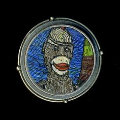 "Cynthia Toops: Tin Toy - Sock Monkey, Small round mosaic brooch in polymer micro mosaic. Sterling silver bezel by Chuck Domitrovich. 1 1/8"" ..."
