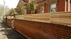 Slatted panels fixed to the top of a wall