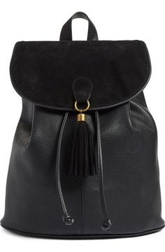Featuring a chic velvet flap and tassel, this textured faux-leather pack looks like a million bucks but won't bust the bank account. A deep, lined interior, sturdy webbed straps and antiqued golden hardware complete the stylish look.