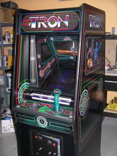 Tron upright (Bally Midway, Unfortunately, the programming for this arcade game had a glitch. At the higher levels (Battle Tanks vs Recognizers), . Arcade Game Room, Retro Arcade Games, Arcade Game Machines, Arcade Machine, Vintage Video Games, Retro Video Games, Video Game Art, Pinball, Bartop Arcade