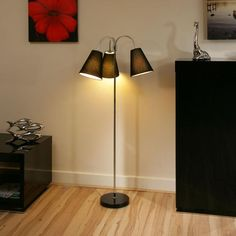 Black standard/floor lamp ultra modern.  A truly stunning item with ultra modern black base and 3 Elegant Shaped Black fabric shades all on flexible arms.  Made by Europe's top lighting manufacturer, please do not confuse with cheap Asian copies.