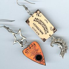 Ouija board planchette Earrings Occult Fortune by DesignsByAnnette. $17.00, via Etsy.