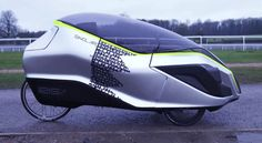 The Iris eTrike is an electric hybrid recumbent tricycle with a plastic canopy