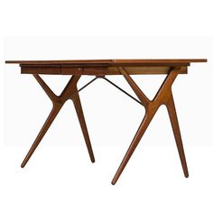 Desk in Teak, Oak and Brass Produced in Denmark | From a unique collection of antique and modern desks and writing tables at https://www.1stdibs.com/furniture/tables/desks-writing-tables/