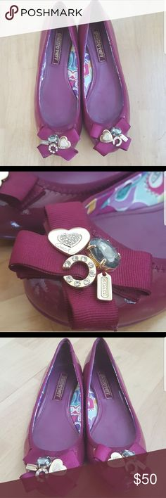 """COACH Poppy Patent Leather Ballet Flats """"Caper"""" These are a pair of authentic Coach Poopy Patent Leather Flats in size 8B. The color is a rich purplish pink, almost magenta. The toes are embellished with Gold Coach logo's and beautiful BLING!! Very gently worn, pre-owned condition. Reposhing...they were a bit small for me :(  They run true to size But they are gorgeous almost new condition Coach Shoes Flats & Loafers"""