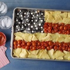 When the calendar turns to Memorial Day, the 4th of July, Flag Day, Veterans Day, or any other patriotic holiday, it's the perfect day for flag nachos made on a sheet pan. Just a bit of strategic placement and this easy party appetizer is ready to feed 8 or so guests. #4thofjuly #4thofjulyfood #americaflagnachos #sheetpannachos #appetizerideas #bhg Blue Corn Tortillas, Blue Corn Tortilla Chips, White Cheddar Cheese, Refried Beans, Melted Cheese, Appetizers For Party, Nachos, Sheet Pan, Food Videos